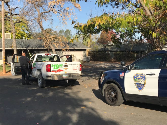Redding police search a vehicle involved in a chase Monday morning in the area of Belladonna and King streets off Shasta View Drive.