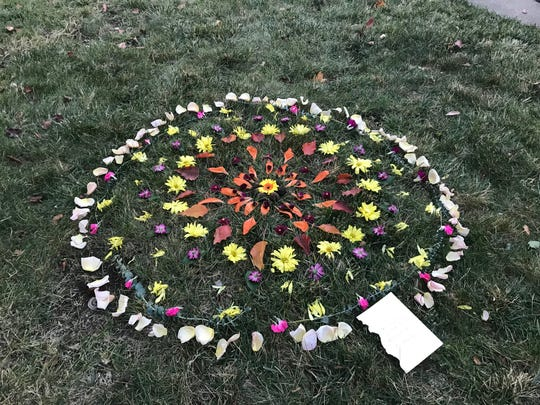 Visitors at the Camp Fire vigil on Sunday in Chico helped build a mandala outside the First Christian Church.