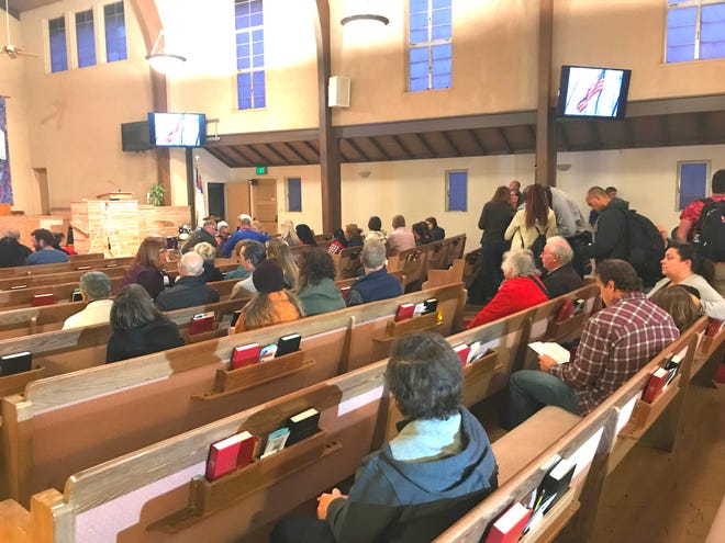 Dozens of residents attended a vigil for Camp Fire victims Sunday at the First Christian Church in Chico.