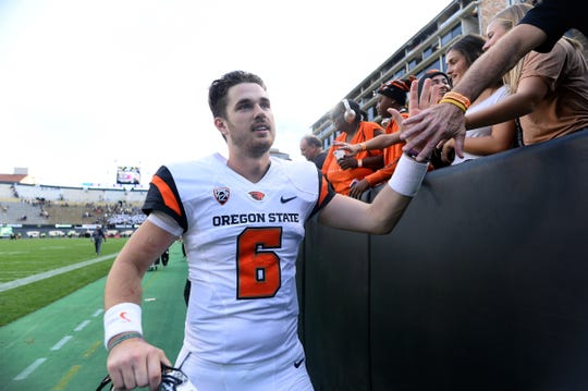 Oct 27, 2018; Boulder, CO, USA; Oregon State quarterback Jake Luton (6) celebrates following an overtime win against Colorado at Folsom Field.