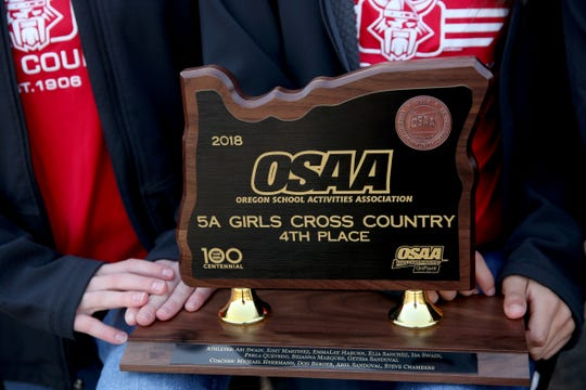 The North Salem girls cross country team placed fourth in the 5A state meet, earning the school's first trophy at the state meet. Photographed at North Salem High School on Monday, Nov. 19, 2018.