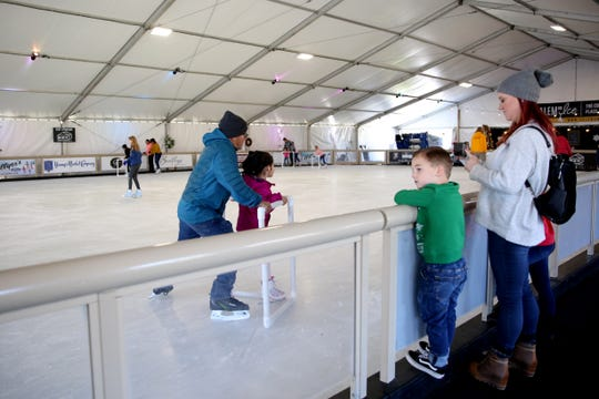 Families skate during the 2018 opening weekend at Salem On Ice in at Riverfront Park on Sunday, Nov. 18, 2018, in Salem.