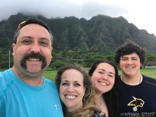 The McMann family, from left to right, parents Kyle and Carol with daughter Lauren and son Ben, during a family vacation in Hawaii.