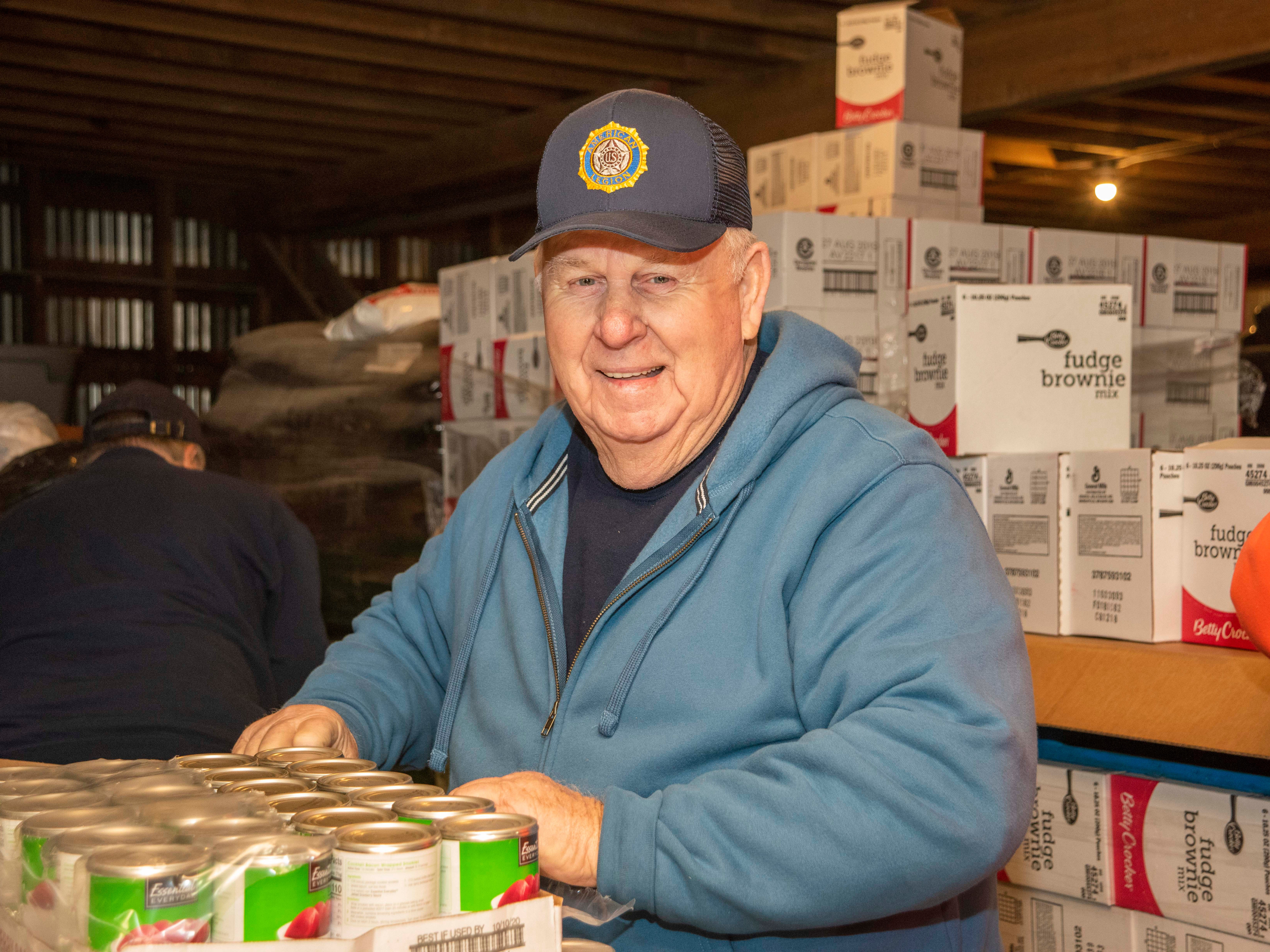 Bill Hitchens, Post Commander, American Legion #24 of Dagsboro helps pack boxes of food for Thanksgiving for Thousands