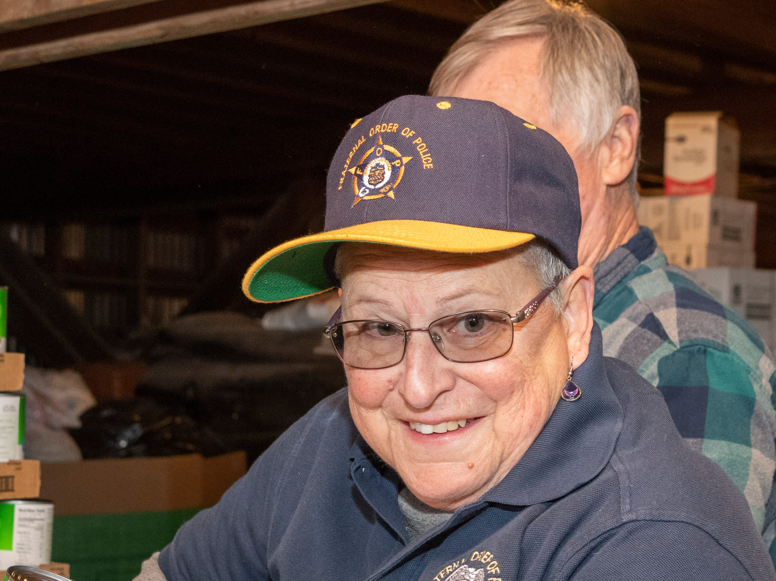 Sally Byrne, FOP Lodge #16, Ocean View/Bethany Beach helps pack boxes of food for Thanksgiving for Thousands.