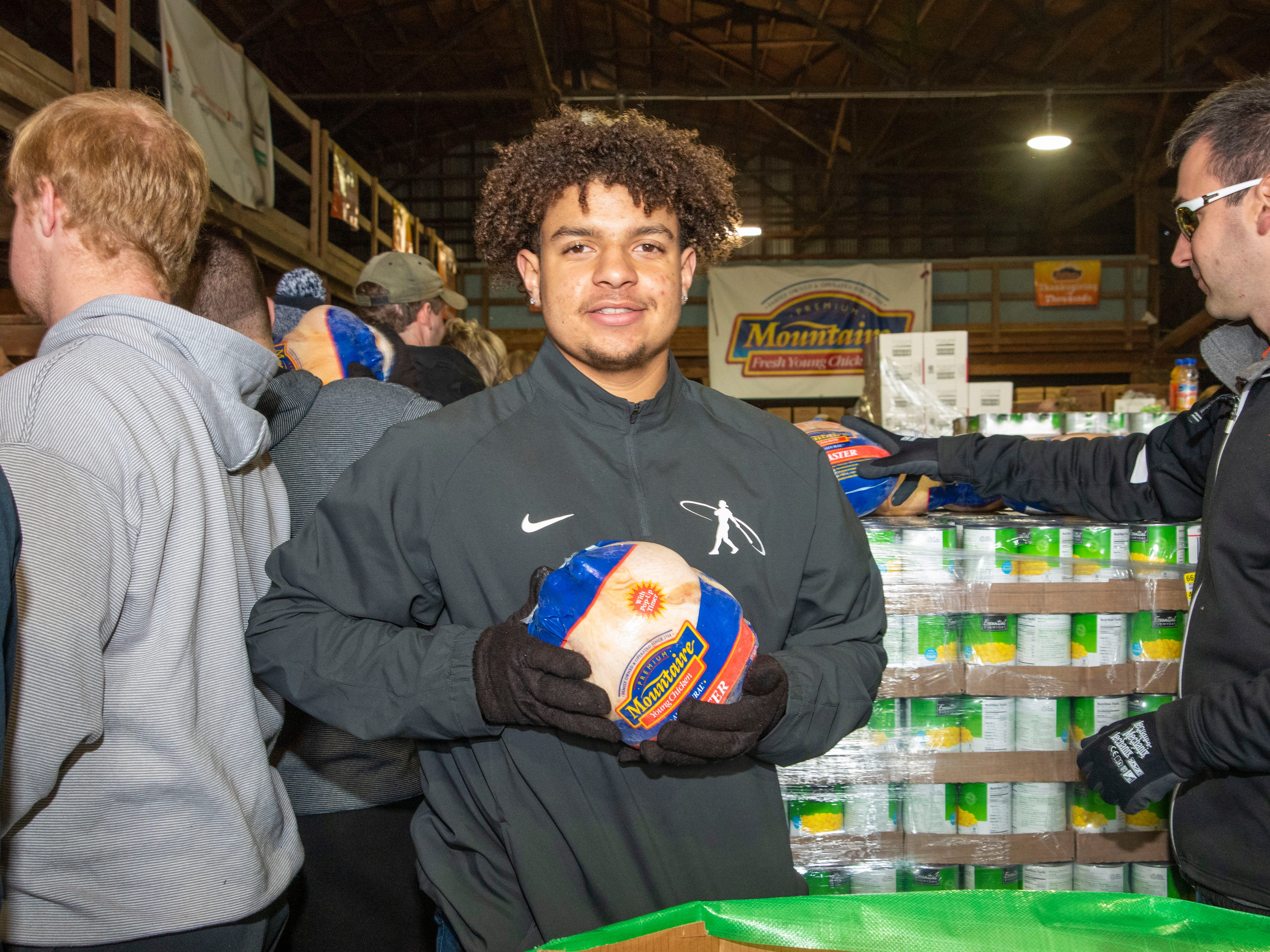 Volunteer and Sussex Tech student Nick Kellam is happy to help pack holiday meals for Thanksgiving for Thousands, Selbyville.