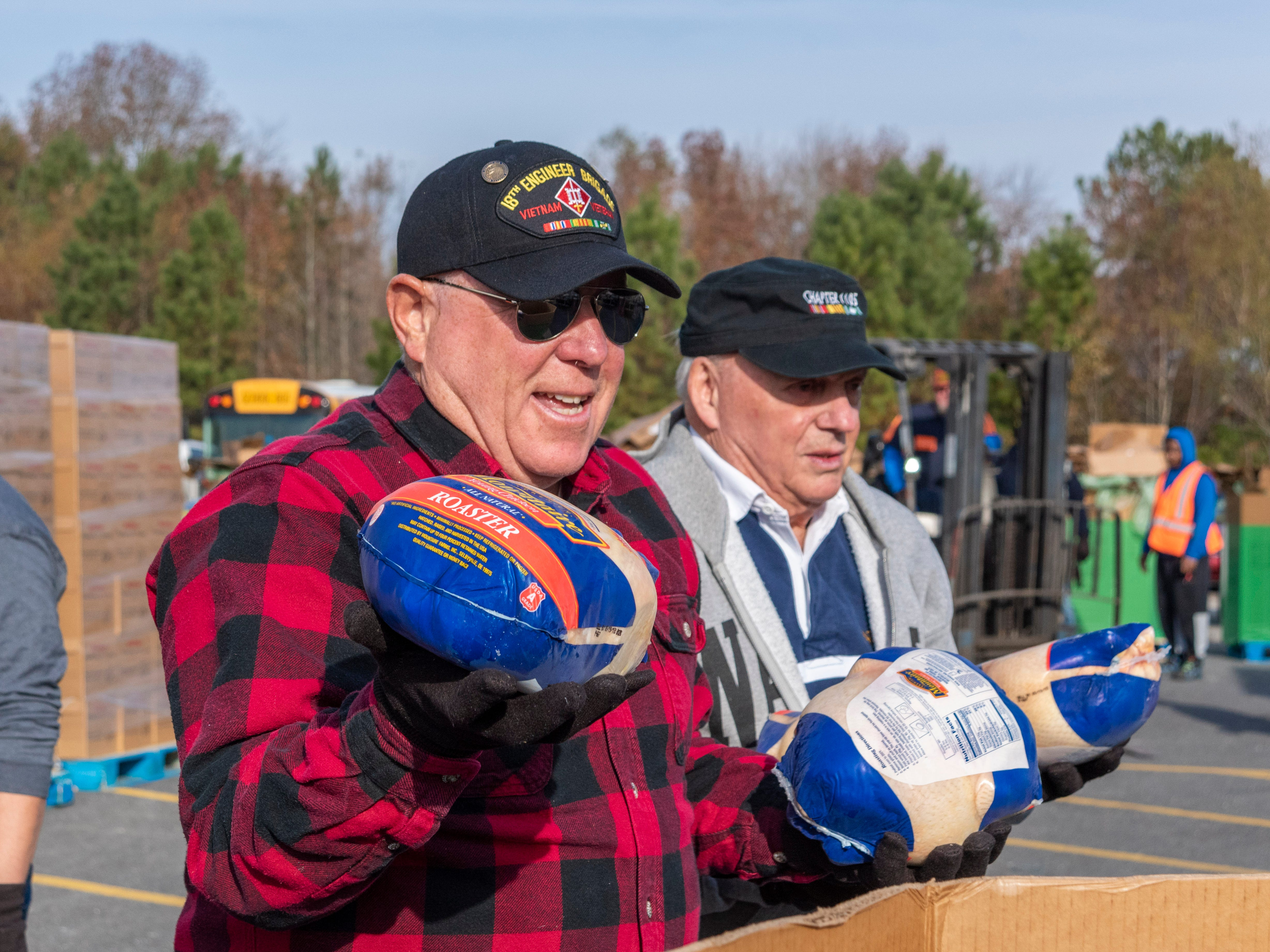 Bruce Graber, Vietnam Veterans of America, Chapter #1105, Millsboro helps pack chickens as part Thanksgiving for Thousands on Monday, Nov. 19, 2018.