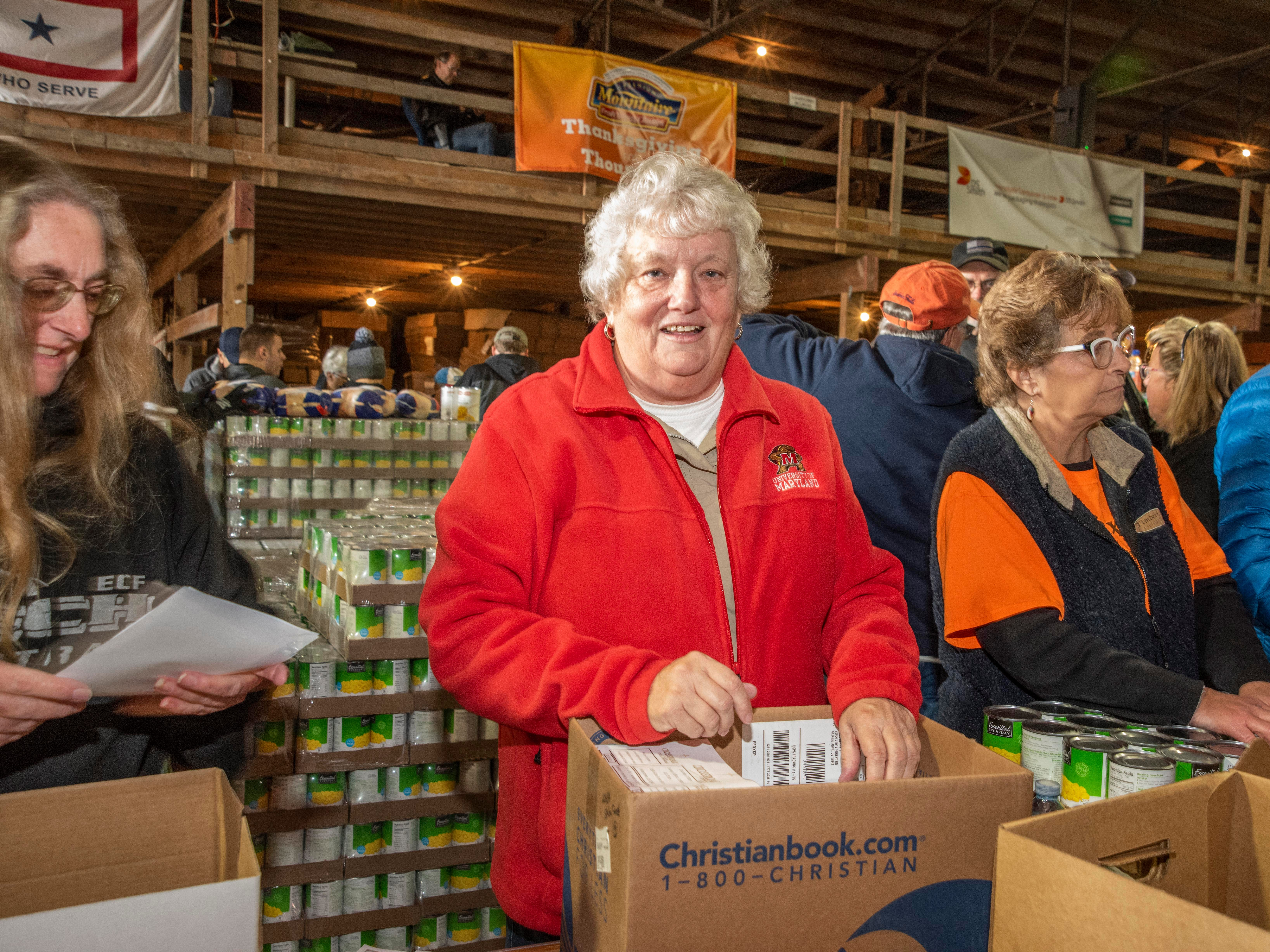 This is the second year Teri Kennedy of Ocean View has volunteered to pack boxes of food for the Thanksgiving for Thousands Event.