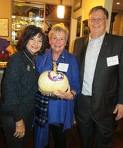 Dr. Marsha Friedrich, Coni Fisher, Louisiana Tech Prez Les Guice check out a pumpkin which out-of-the blue  during an auction benefitting VISTA Friedrich surprised the crowd by upping the bidding  to $500.
