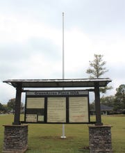 The neighborhood where a Barksdale airman was shot and killed in September has erected a flagpole in his memory.