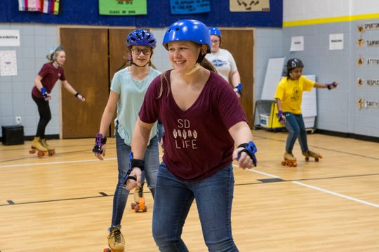 Sioux Falls Lutheran School students learn how to skate Monday, Nov. 19, 2018, during P.E. class in Sioux Falls, South Dakota.