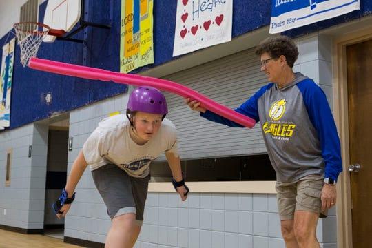 Melanie Nelson, physical education teacher, teaches students how to skate Monday, Nov. 19, 2018 at Sioux Falls Lutheran School in Sioux Falls, South Dakota.