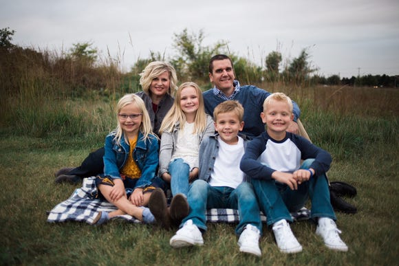 Malchow posed for a family portrait this year with wife Sarah and (left to right) daughters Katie and Macy and twin sons Jake and Cole.
