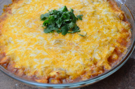 The enchilada dip is layered with cream cheese, beans, cheese and baked until bubbly. It pairs well with the cranberry margaritas.