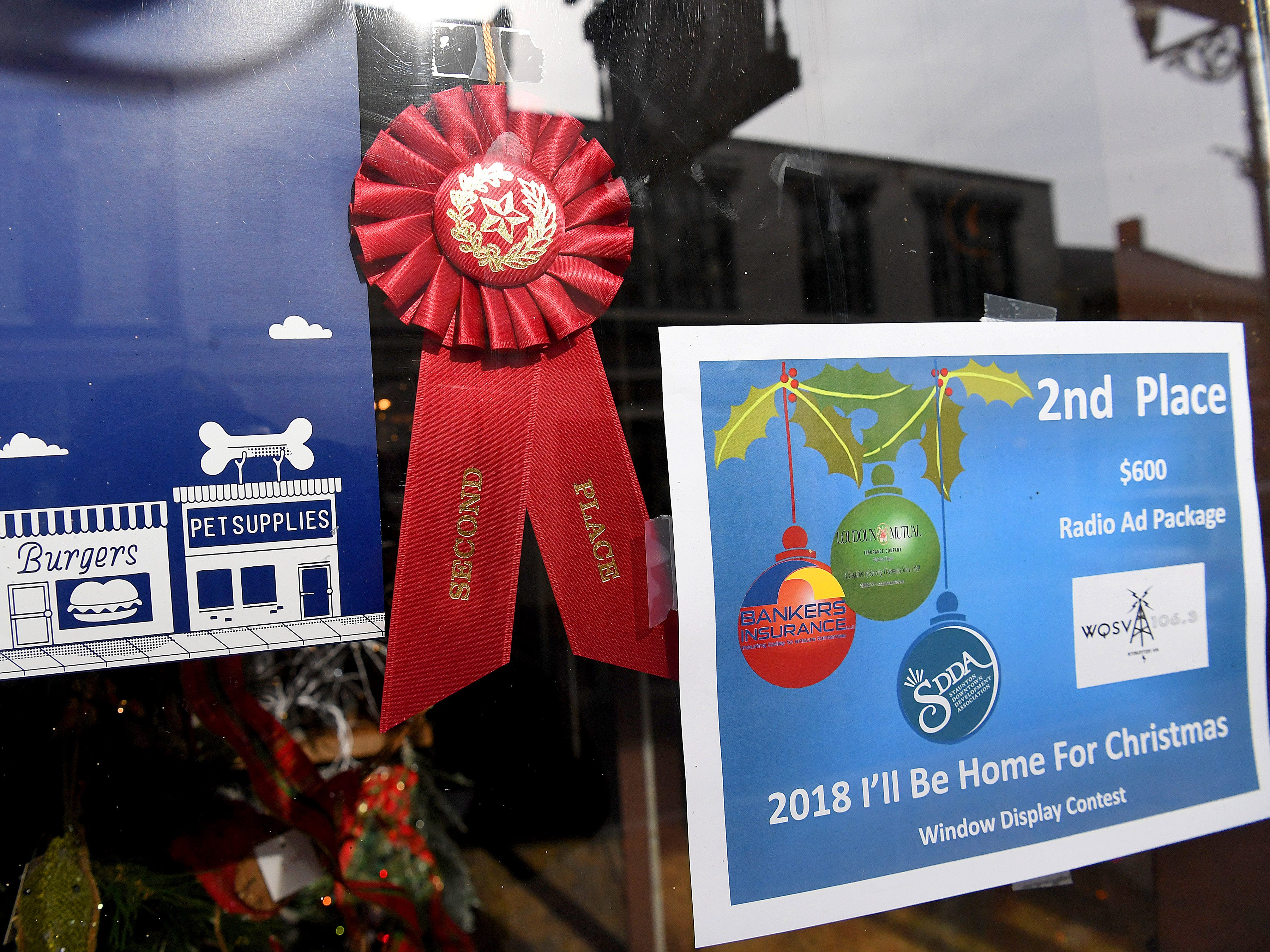 Cherish Every Moment's holiday window display placed second in Staunton Downtown Development Association's holiday storefront window display judging contest.