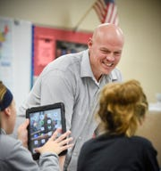 Teacher Trent Ziegler works with students in his seventh-grade social studies class on a project Monday, Nov. 19, at the Sauk Rapids-Rice Middle School in Sauk Rapids.