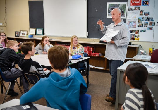 Teacher Trent Ziegler gets his seventh-grade social studies class students started on a project Monday, Nov. 19, at the Sauk Rapids-Rice Middle School in Sauk Rapids.