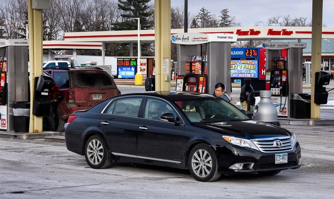 Drivers fill up their vehicles at the Holiday and Kwik Trip stations Monday, Nov. 19, along 18th Street North near Minnesota Highway 15 in Sauk Rapids.
