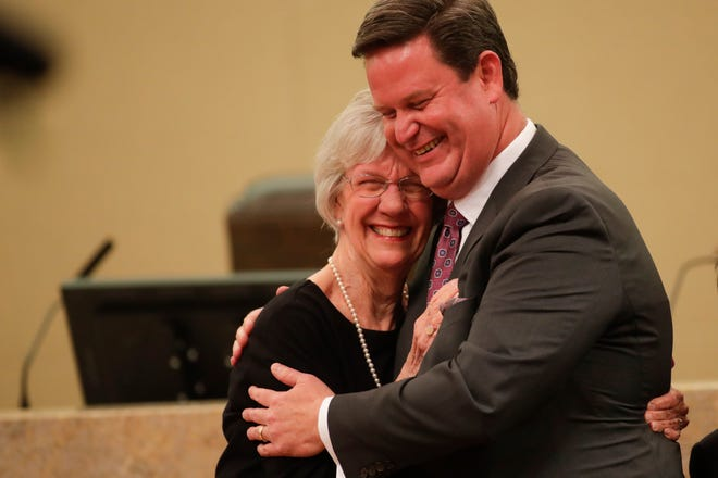 Mayor John Dailey hugs his mom after being sworn in as mayor during the Tallahassee City Commission reorganization meeting Monday, Nov. 19, 2018.