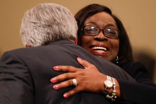 After being sworn in as a city commissioner, Dianne Williams-Cox hugs City Treasurer Jim Cooke during the Tallahassee City Commission reorganization meeting Monday, Nov. 19, 2018.