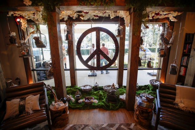 "Hearth and Soul revealed their 2018 holiday window design Monday, Nov. 19, 2018. The window's theme is ""Peace on Earth"" and features 25 bird cages with giveaways inside."