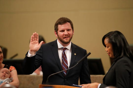 Jeremy Matlow is sworn in as a city commissioner during the Tallahassee City Commission reorganization meeting Monday, Nov. 19, 2018.