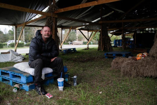 Phil March spends his days in the area around Maclay Commerce Drive off Thomasville Road in Tallahassee. On Wednesday, Nov. 14, 2018, March spent his day seeking shelter from the cold and trying to stay warm under a space used to sell pumpkins and Christmas trees across the street from the Circle K where his life changed.