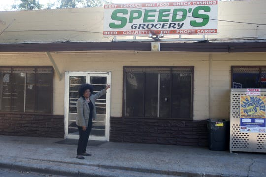 Jacqueline Perkins, a retired FAMU staff director, poses for a photo outside Speed's Grocery located on Floral Street in the Bond Neighborhood, Friday, Nov. 16, 2018.