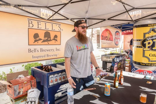 Eric Riggins of Bell's Brwery mans his booth at the Treasure Coast Brew Fest at Tradition Square in Port St. Lucie.