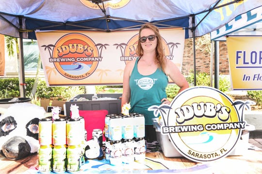 Heather Sykes with JDubs Brewing Co. waits for customers at the Treasure Coast Brew Fest at Tradition Square in Port St. Lucie.
