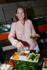 Avery Twiss samples some of the tasty treats prepared by Wild Thyme Catering at Treasure Coast Food Bank's Fall Harvest Dinner at Schacht Groves in Vero Beach on Nov. 10.
