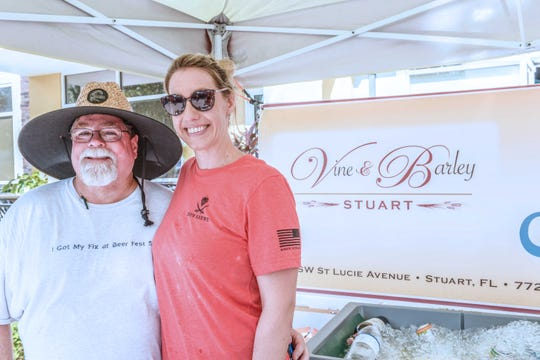 Alan Ewing, left,  with Jen Carbone at the Vine & Barley Stuart booth at the Treasure Coast Brew Fest at Tradition Square in Port St. Lucie.