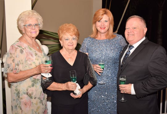 Bette Maxwell, left, Shirley Emond, Wendy Maxwell and New Horizons Board Director Greg Childress at the New Horizons Diamond Jubilee at Harbour Ridge Yacht and Country Club in Palm City.