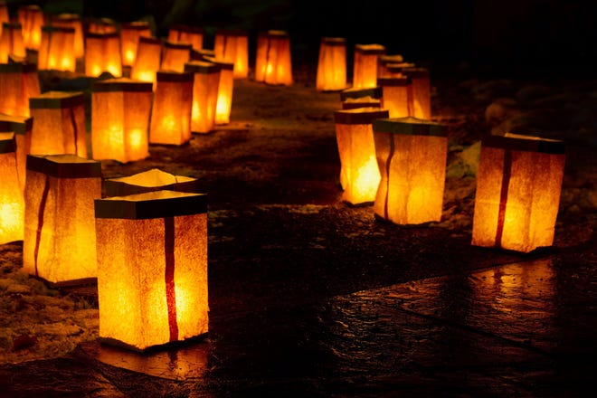 Photo credit 1: Laurie Michaud Photo caption 1: Luminarias will line the path at Merry Meows