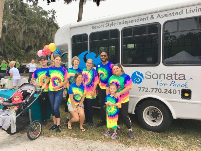 Team Sonata Senior Living Vero Beach strikes a colorful pose at the 2018 Walk To Remember on Nov. 3 at Riverside Park in Vero Beach.