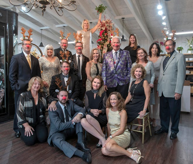 "The 2018 Festival of Trees & Lights ""Dames and Deers"" are, from left, back row, Dave Derrenbacker, Shawn Kelly, Randy Pennington, Dr. Brian Moriarty, Kelly Johnson, Joyce Page, Frank Byers Jr., Rebecca King, Sue Whittington, Patty O'Connell and Tom Whittington; front row: Debbie Denning, Michael Bonan, John Gonzalez, Cory Rubal, Debbie Maunus and Diana Hoover."