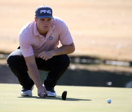 Mason Overstreet of Arkansas studies his putt on the 18th hole Monday at El Paso Country Club.