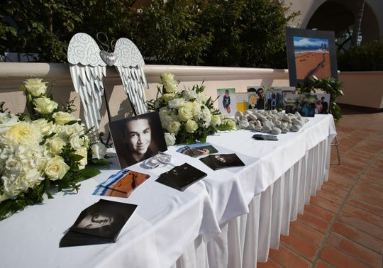 A table full of photos remembering Mark Meza Jr. was set up during his celebration of life ceremony at the Hilton Resort in Santa Barbara on Sunday.