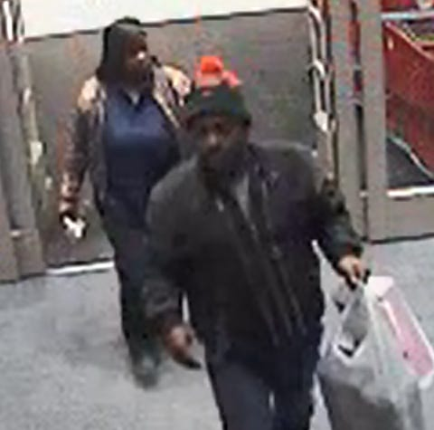Surveillance image of suspects police believe used counterfeit money at Target and Walmart in Millville.