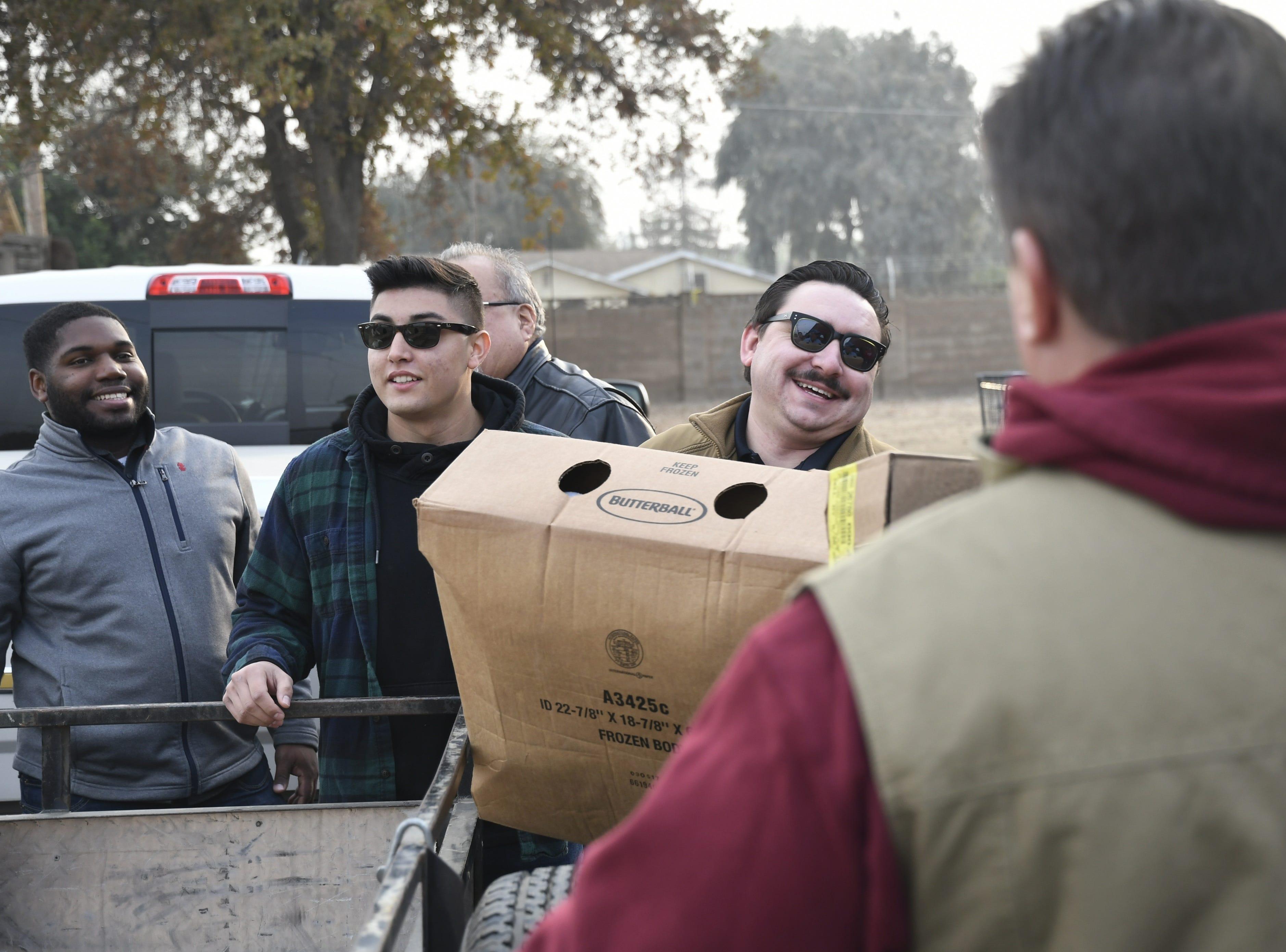 Members of Visalia Breakfast Lions Club delivered more than 1,100 turkeys on Monday, Nov. 19.