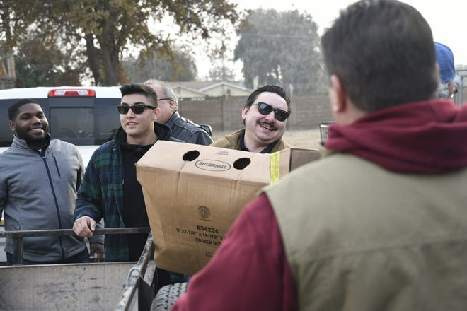 Members of Visalia Breakfast Lions Club delivered more than 1,100 turkeys on Monday, Nov. 19.