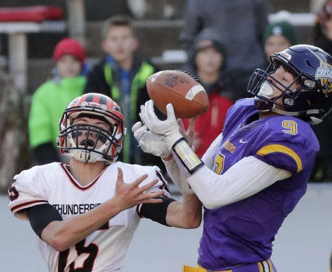Iola-Scandinavia's Connor Kurki, left, defends a pass intended for Racine Lutheran's Josh Hess in the WIAA Division 6 championship game Thursday at Camp Randall Stadium in Madison.