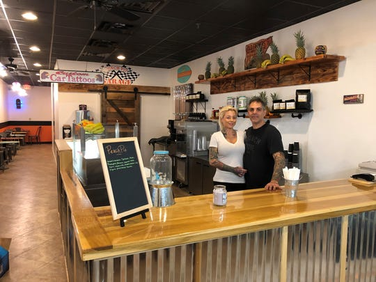 Shannon Deo and David Bagatta behind the counter of their new New City spot, Peach Pit.