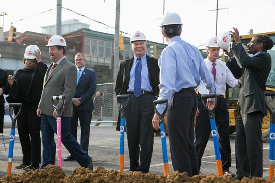 Wilmington Mayor Mike Purzycki smiles as he chats with Gov. John Carney as they join other dignitaries for a groundbreaking ceremony to kick off the new transit center that will be constructed on State-owned land just east of Walnut Street and north of Front Street, adjacent to the Joseph R. Biden Jr. Railroad Station.