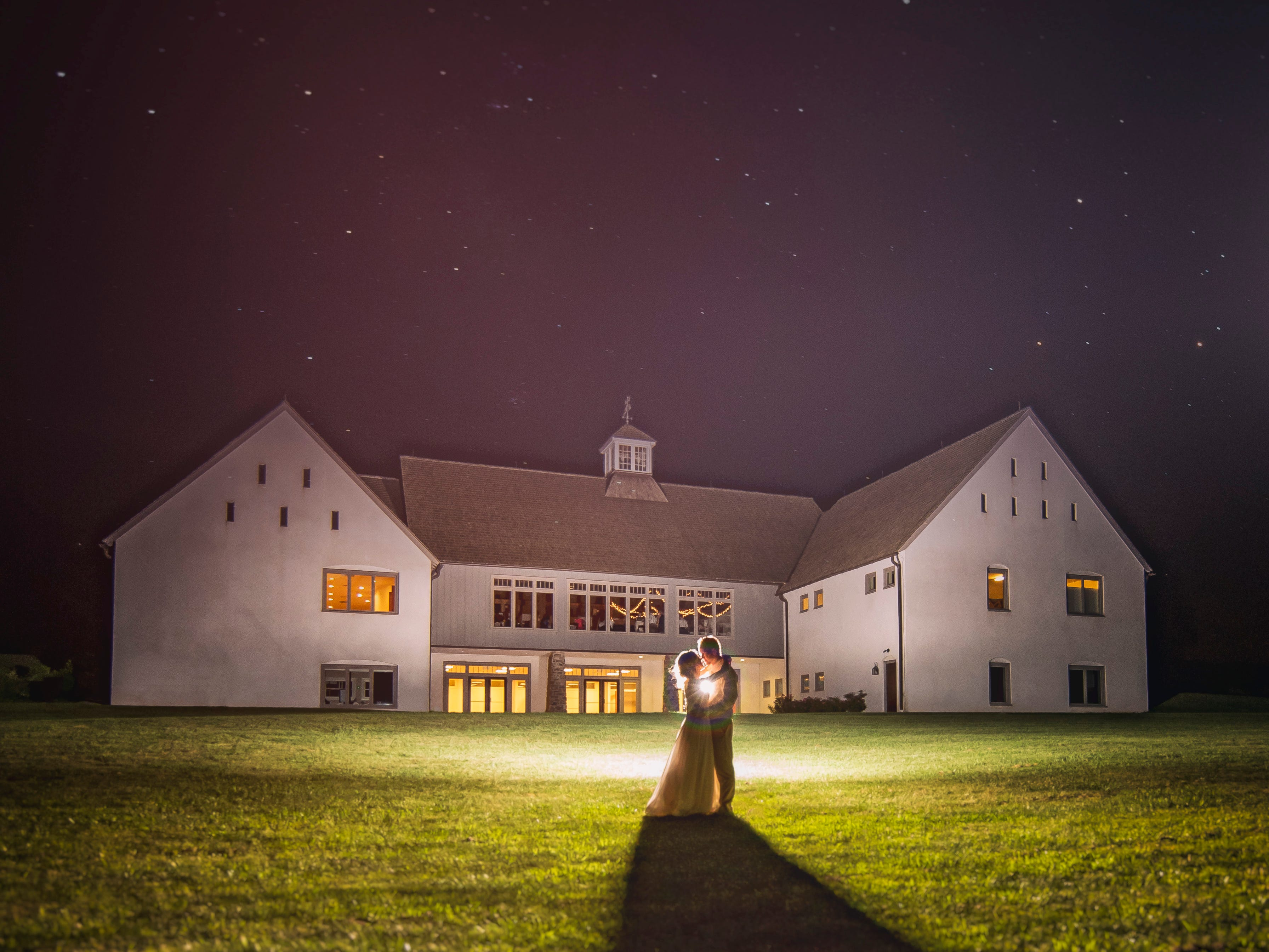 Lighted night shots capture wedding style, location, couple in fairy tale lights