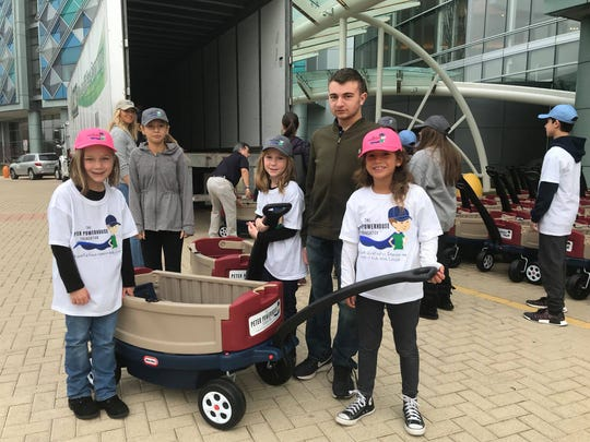 On Monday, Peter Zucca, a 15-year-old cancer survivor, and several volunteers with The Peter Powerhouse Foundation drop off 100 donated wagons at Nemours/A.I. duPont Hospital for Children in Wilmington.