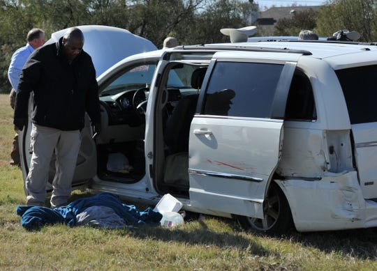 Wichita County Deputies search a vehicle after a pursuit Monday morning.