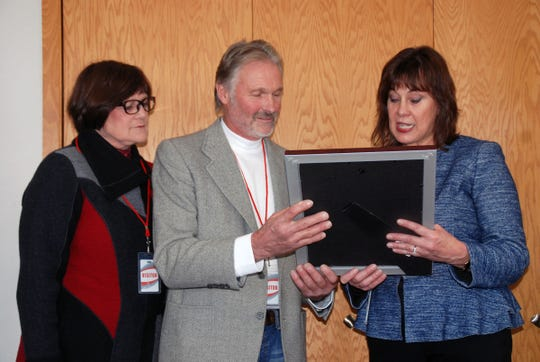The selection of David Geiser of Gold Star Dairy in Calumet County, as winner of the Leopold Conservation Award was announced at the Nov. 15 meeting of the state board of Agriculture, Trade and Consumer Protection. He is pictured with his wife Deb Reinhart, left, a partner in the farm. Secretary Sheila Harsdorf marked the announcement with a proclamation from the governor's office recognizing the achievement.