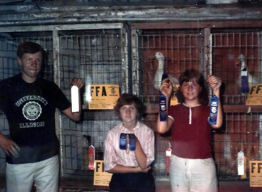 Cousins George, Susan and Karen show off their hard-earned ribbons following the 1966 FFA poultry show.