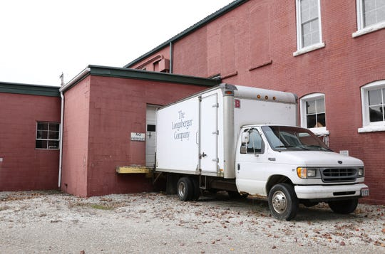 A truck sits outside the building that briefly held Longaberger's final production facility on Main Street in Dresden.